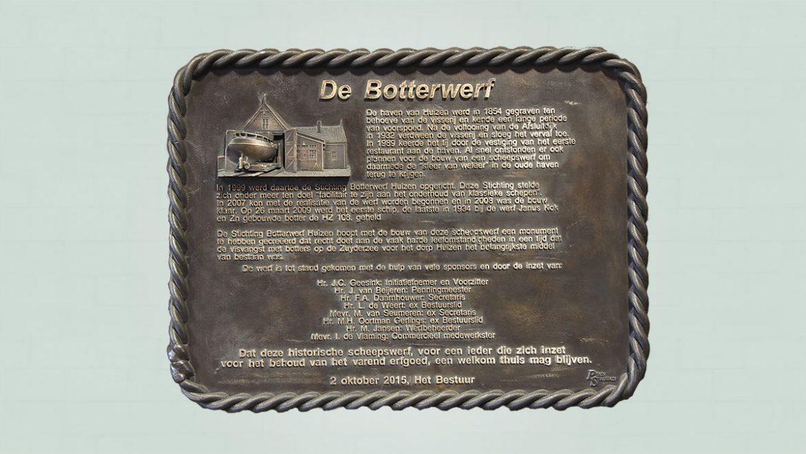 bronzen plaquette en bas relief met beeld element en 3d tekst